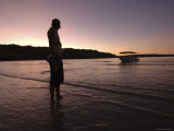 Person and Boat Silhouetted at Sunset, Faraway Bay, Kimberley, Western Australia Photographic Print by Michael Gebicki