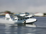 Float Plane Taking Off from Lake Hood, Anchorage, Alaska Fotografie-Druck von Brent Winebrenner
