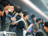 People Studying Form Guide at Seoul Racecourse, Seoul, South Korea Photographic Print by Anthony Plummer