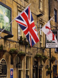Flags Hanging Outside a Pub, Stow-On-The-Wold, Gloucestershire, England Fotografisk tryk af Glenn Beanland