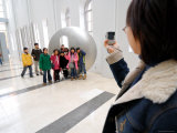 Woman Taking Group Photo Inside Seoul Museum of Art, Myong-Dong, Seoul, South Korea Photographic Print by Anthony Plummer