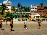 Locals Playing Soccer on la Madera Beach, Zihuatanejo, Guerrero, Mexico Photographic Print by Richard Cummins