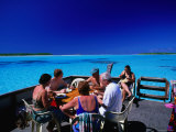 Boat in Aitutaki, Cook Islands Photographic Print by Peter Hendrie