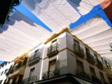 Awnings over Calle Sierpes Street, Sevilla, Andalucia, Spain Fotodruck von John Elk III