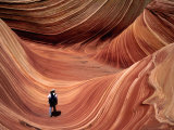 Man Walking through the Wave Formation, Vermillion Cliffs National Monument Photographic Print by Mark Newman