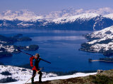 Cross Country Skier with Lake and Mountains in Background Photographic Print by Mark Newman