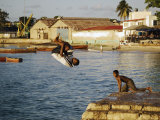 Children Diving in Sea at Waterfront, Stone Town, Zanzibar Town, Zanzibar West, Tanzania Photographic Print by Ariadne Van Zandbergen