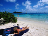 Relaxing on Beach, Petit Rameau, Tobago Cays Photographic Print by Holger Leue