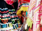 Woman in Traditional Hat Looking through Textiles and Fabric of Stall, Peru Photographic Print by Richard I'Anson
