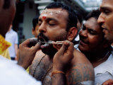Devotee Having Cheeks Pierced During Thaipusama Festival, Singapore Photographic Print by Michael Coyne