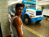 Man Waits for Bus in Torrential Tropical Downpour in Zona Centromexico Photographic Print by Anthony Plummer