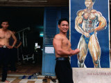 Weight Lifter Flexes at Facility Inside Cao Dai Temple Complex, Tay Ninh, Vietnam Photographic Print by Stu Smucker