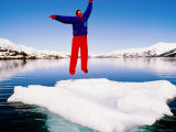 Man in a Survival Suit Jumping on an Ice Floe, Blackstone Bay, Prince William Sound, Alaska Photographic Print by Mark Newman