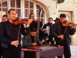 Gypsy Band Performing in Place du Peyrou, Sarlat-La-Caneda, Aquitaine, France Photographic Print by Roberto Gerometta