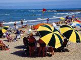 Beach Umbrellas and People on Playa el Emir in Summer, Punta del Este, Maldonado, Uruguay Photographic Print by Krzysztof Dydynski