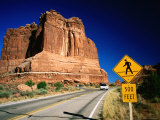 Road Sign in Front of Courthouse Towers, Arches National Park, Utah Photographic Print by David Tomlinson