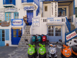 Motorbikes Parked Outside Shops Photographic Print by Diana Mayfield