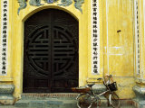Yellow Nguyen Thai Hoc Temple Entrance and Bicycle, Hanoi, Vietnam Photographic Print by Anthony Plummer
