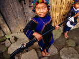 Two Ethnic Ha Nhi Girls Carry Locally Made Flint Lock Rifle, Muong Hum, Lao Cai, Vietnam Photographic Print by Stu Smucker