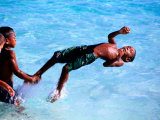 Children Playing in Water, Lifou Island, Loyalty Islands, New Caledonia Photographic Print by Peter Hendrie