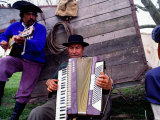 Two Gaucho Musicians Playing Guitar and Accordion, Buenos Aires, Argentina Fotografie-Druck von Michael Coyne