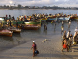 People on Shore Near Fishing Boats, Dar Es Salaam, Tanzania Photographic Print by Ariadne Van Zandbergen