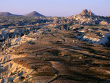 Eroded Landscape with Uchisar Town and Kale in Distance, Cappadocia, Nevsehir, Turkey Photographic Print by John Elk III