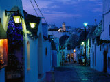 Typical Cobbled Lane in Trulli District at Dusk, Alberobello, Puglia, Italy Photographic Print by David Tomlinson