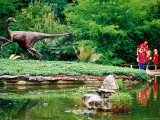 Children and Adult Standing near Ornithomimus Dinosaur Sculpture, Austin, Texas Photographic Print by Richard Cummins