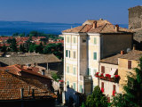 Buildings of Village with Lake Bolsena Beyond, Bolsena, Lazio, Italy Photographic Print by David Tomlinson