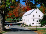 Autumn Leaves and People Outside Plymouth Cheese Factory, Plymouth Notch, Vermont Photographic Print by John Elk III