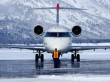 Aircraft at Jackson Hole Airport Surrounded by Snow-Covered Fields and Hills, Jackson Hole, Wyoming Photographic Print by Richard Cummins