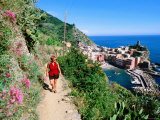 Hiker on Trail Above Town, Cinque Terre, Vernazza, Liguria, Italy Photographic Print by John Elk III
