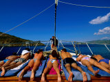 Sunbathers on Bow Deck of Boat on Fethiye Bay, Fethiye, Mugla, Turkey Photographic Print by John Elk III