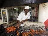 Man Grilling Skewers in Restaurant, Dar Es Salaam, Tanzania Photographic Print by Ariadne Van Zandbergen