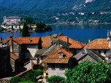 Village Roofs with Lago d'Orta and Isola San Giulio in Background, Orta San Giulio, Piedmont, Italy Photographic Print by Glenn Van Der Knijff