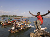 Young Man Clowning Around on Fishing Boat at Kibongoni, Dar Es Salaam, Tanzania Fotografie-Druck von Ariadne Van Zandbergen