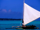 Pirogue with Sail, Ile des Pins, New Caledonia Photographic Print by Peter Hendrie