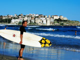 Surfer Carrying Surfboard on Bondi Beach, Sydney, New South Wales, Australia Photographic Print by Holger Leue