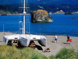 Grounded Yacht and People on Beach, Port Orford, Oregon Photographic Print by Richard Cummins