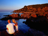 Couple Enjoying Sunset on Rocky Coastline at Hovs Hallar, Hovs Hallar Nature Reserve, Skane, Sweden Photographic Print by Anders Blomqvist