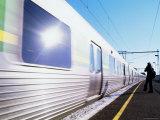 Suburban Train Passing Platform, Melbourne, Victoria, Australia Photographic Print by John Banagan