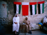 Vendors Sitting in a Bazaar, Dubai, United Arab Emirates Photographic Print by Michael Coyne