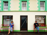 Man and Woman Sitting Outside Pub Entrance, Adrigole, Munster, Ireland Photographic Print by John Banagan