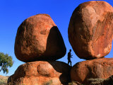 Man Standing in Between Boulders, Devil's Marbles Conservation Reserve, Australia Photographic Print by John Banagan