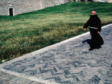 Priest Walks Past a Grassy Lawn in Assisi, Umbria, Italy Photographic Print by Jeffrey Becom