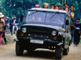 Market Goers in Vietnam Transport Their Produce in Russian Made Jeep, Lao Cai, Vietnam Photographic Print by Stu Smucker