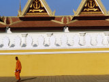 Lone Monk Passes Walls of Royal Palace, Phnom Penh, Cambodia Photographic Print by Daniel Boag