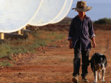 Boy with Dog Walking Past Solar Energy Dishes, New South Wales, Australia Lámina fotográfica por Oliver Strewe