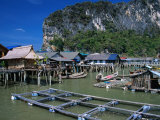 Stilt Village with Net Farms in Front and Karst Formations Behind, Ko Panyi, Phang-Nga, Thailand Photographic Print by Dominic Bonuccelli